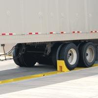 AC Series AUTO CHOCK® In-Ground Wheel Restraint